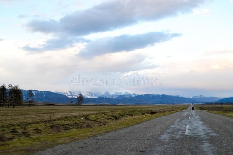 Empty road to the mountains. stock images