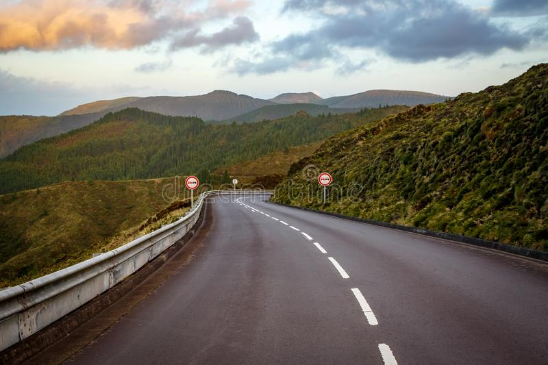 Empty road in the mountains. No overtaking sign. Empty road in the mountains. Sunset. No overtaking sign royalty free stock photography