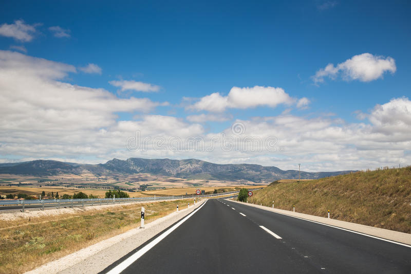 Empty road through the mountains. Spain. royalty free stock image