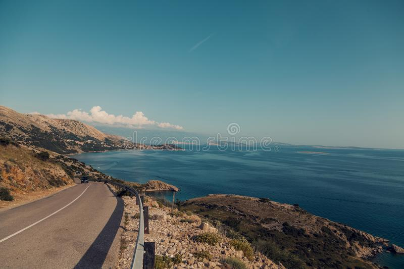 Empty Road Near Calm Body of Water royalty free stock image