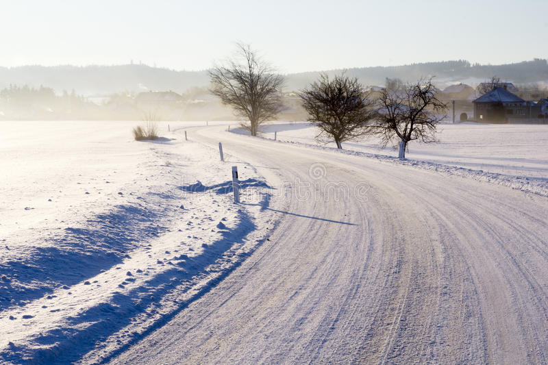 Download Empty Road With Snow Coverage Stock Photo - Image: 83714036