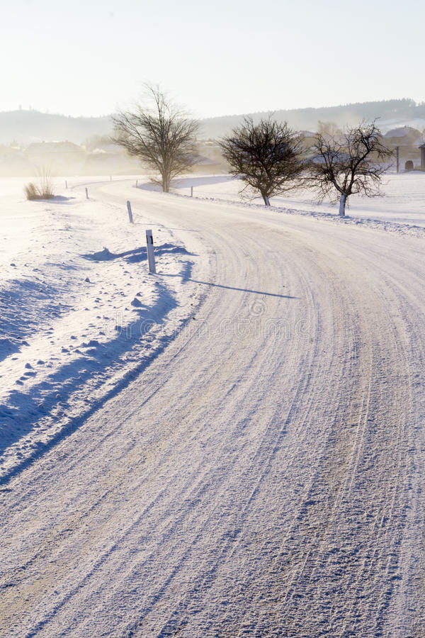 Download Empty Road With Snow Coverage Stock Image - Image: 83715291