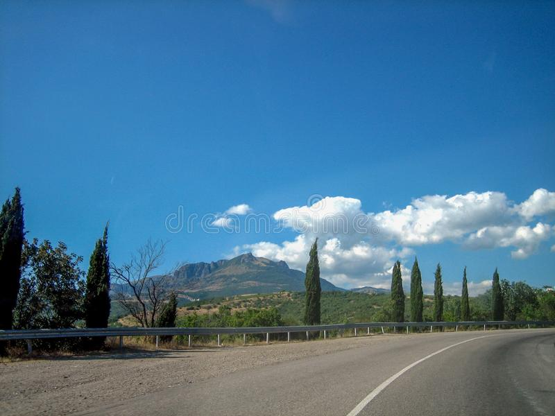 Empty road in the southern hilly-mountainous area on a hot summer day royalty free stock photos