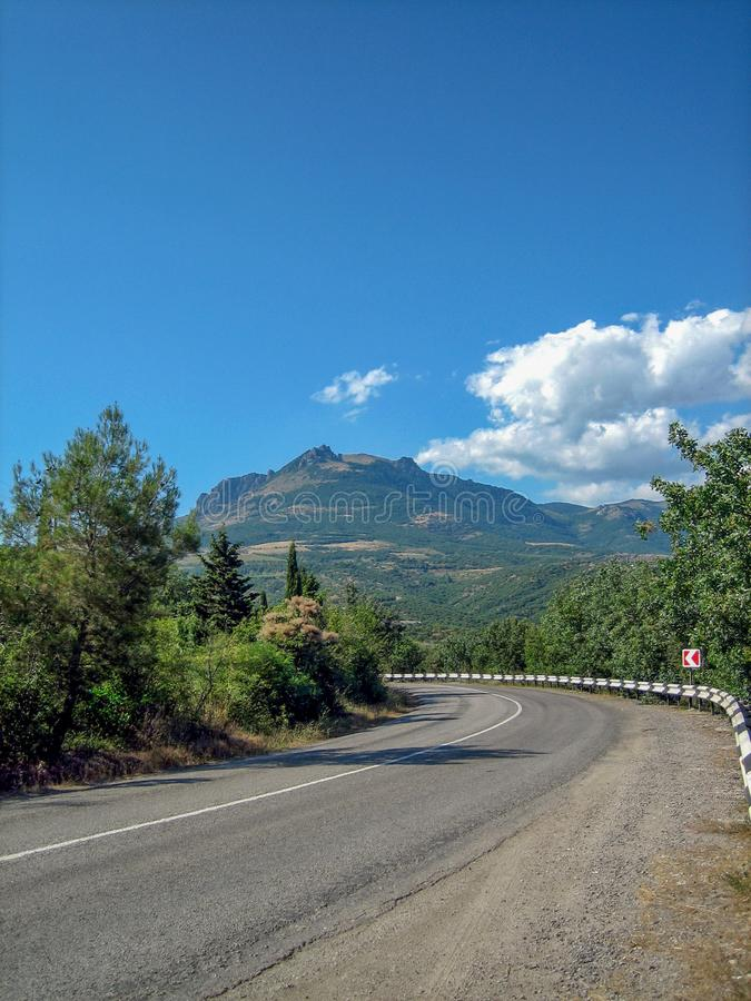Empty road in the southern hilly-mountainous area on a hot summer day royalty free stock image