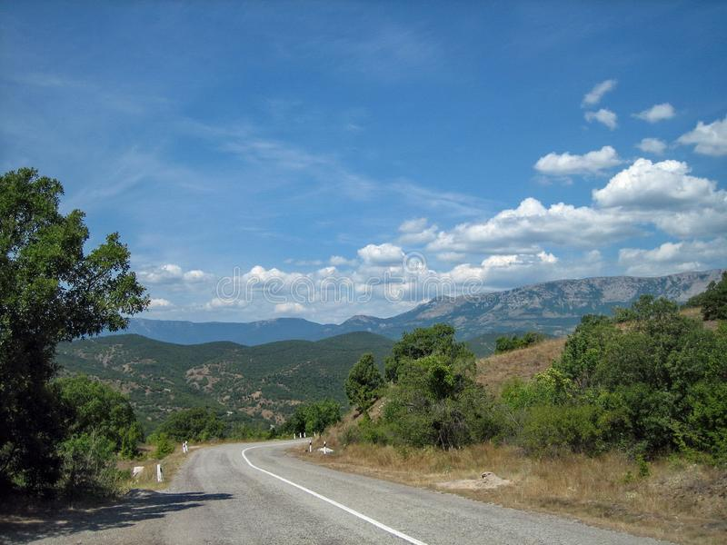 Empty road in the southern hilly-mountainous area on a hot summer day stock image