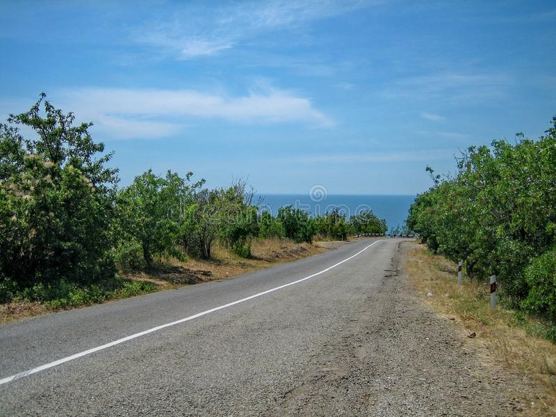 Empty road in the southern hilly-mountainous area on a hot summer day stock photo