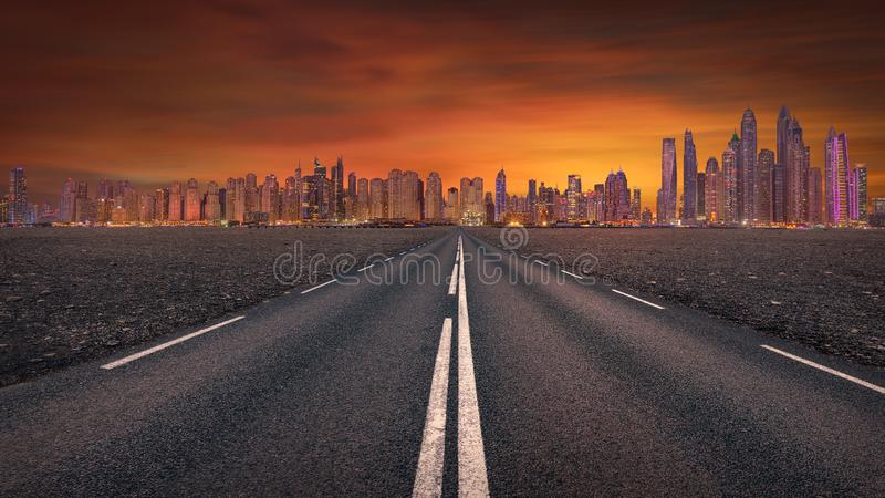 Empty road towards the futuristic skyline stock images