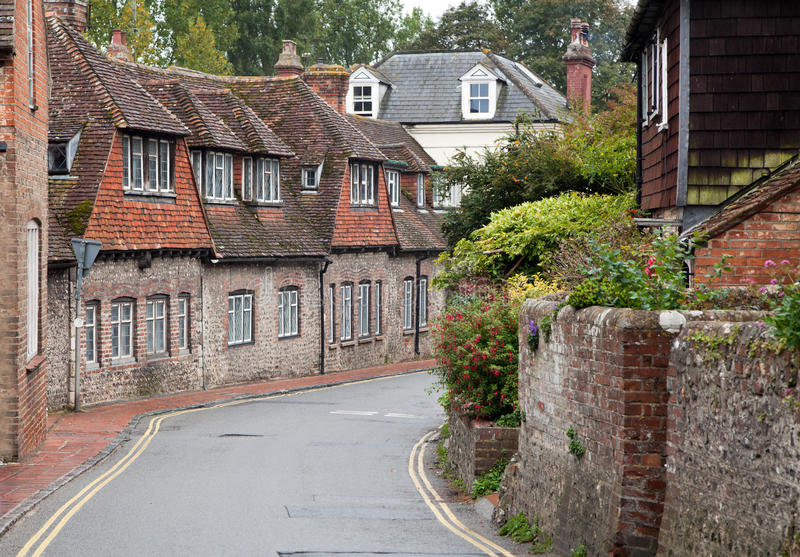 Empty road in a traditional english village stock photography