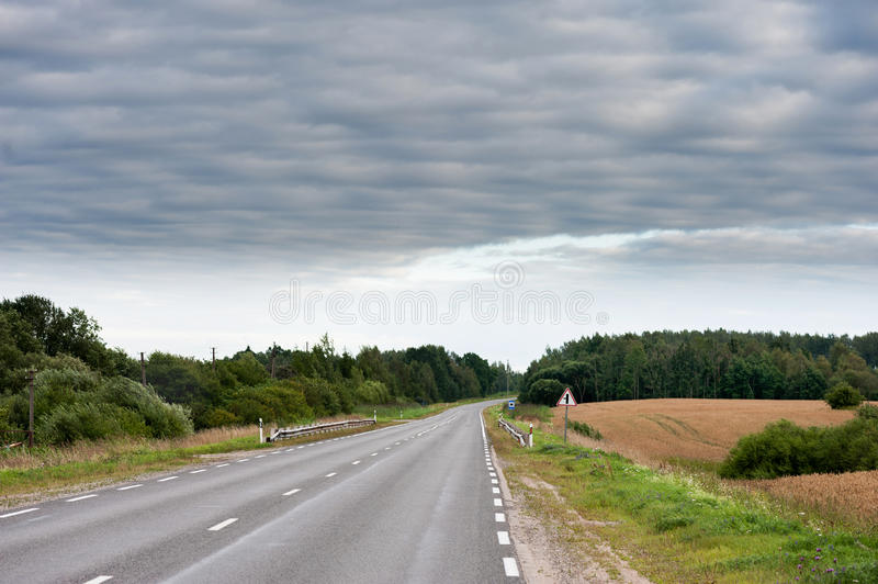 Empty road and Wheat Field royalty free stock photos