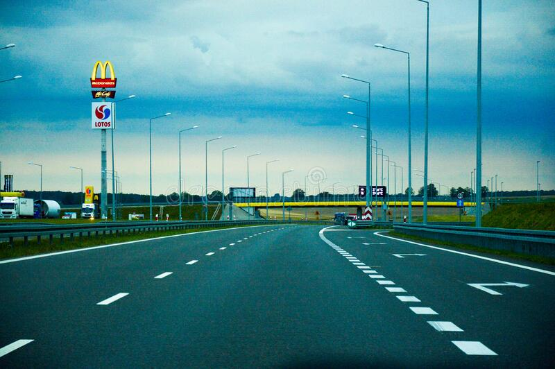 Empty roadway with travel plaza royalty free stock photography