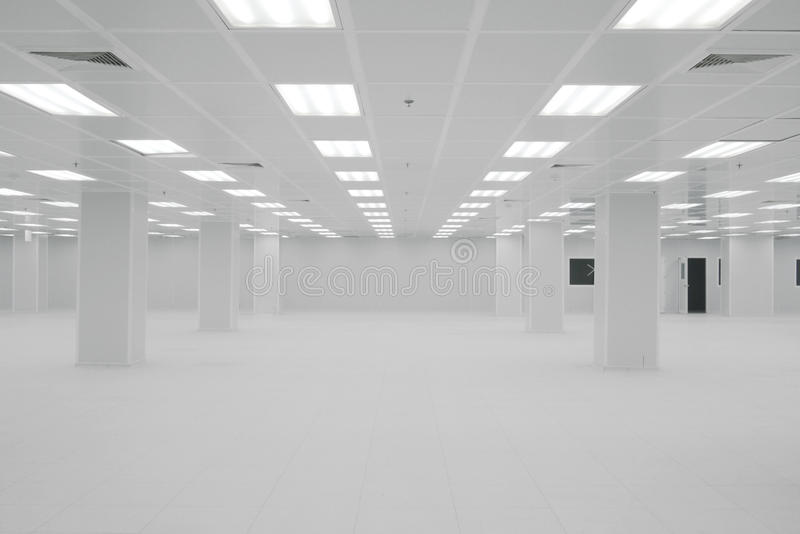 Empty room. Empty new white cleanroom in factory side royalty free stock images