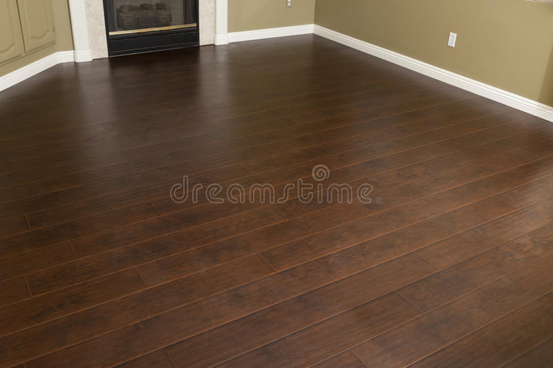 Empty Room with Brown Laminate Flooring stock images