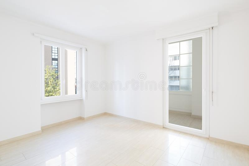 Empty room, clean white walls after renovation. Empty room, clean white walls stock images