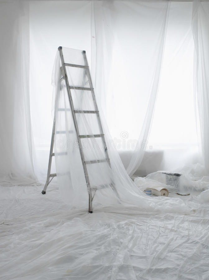 Empty Room Covered In Dust Sheets royalty free stock images