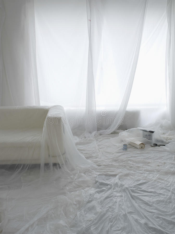 Empty Room Covered In Dust Sheets stock photo
