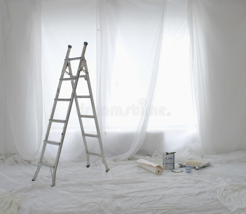 Empty Room Covered In Dust Sheets royalty free stock photo