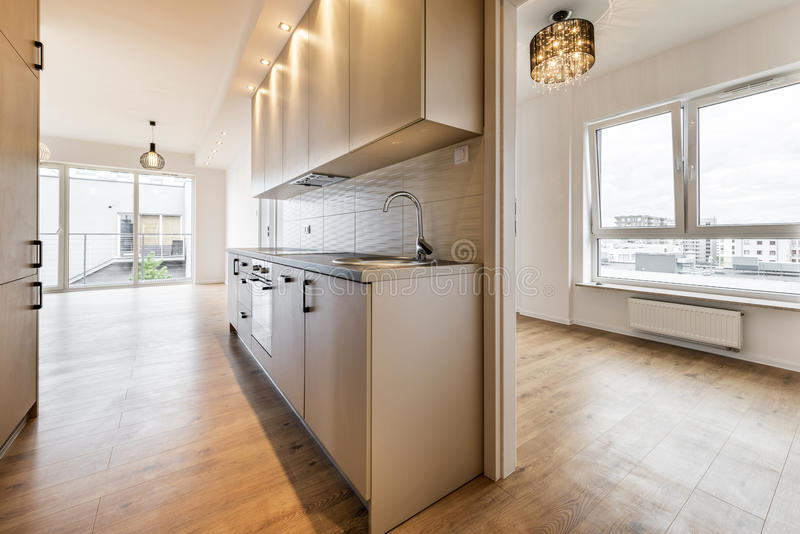 Empty room with domestic kitchen. New apartment, empty room with domestic kitchen interior design royalty free stock photography