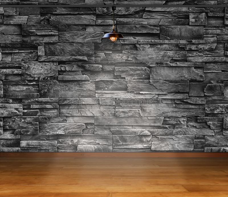 Empty room - granite stone decorative brick wall with lamp and laminate flooring interior background, interior template for stock photo