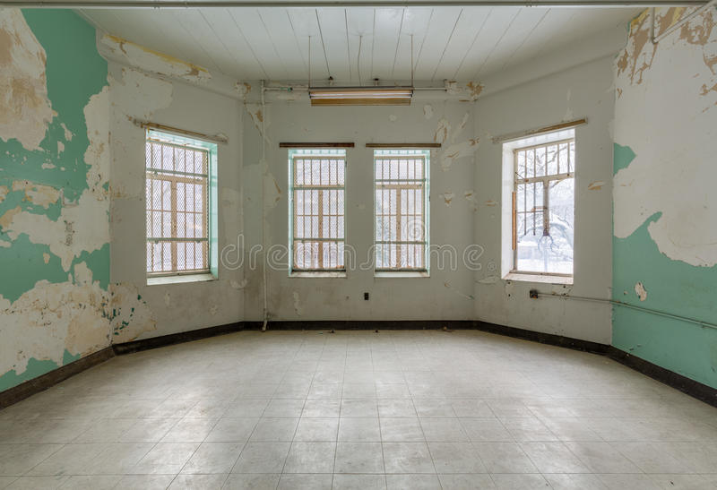 Empty room inside Trans-Allegheny Lunatic Asylum. Empty room with windows inside Trans-Allegheny Lunatic Asylum in Weston, West Virginia, USA stock photos
