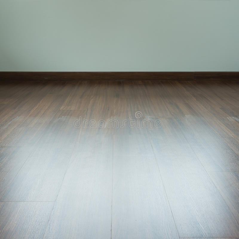 Empty room interior, brown wood laminate floor. And white mortar wall stock images