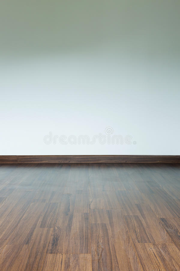 Empty room interior, brown wood laminate floor. And white mortar wall background stock photo