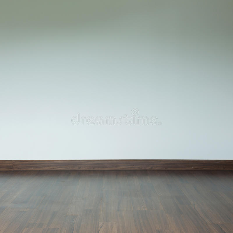 Empty room interior, brown wood laminate floor and white mortar. Wall background stock photography