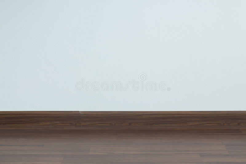 Empty room interior, brown wood laminate floor and white mortar. Wall background royalty free stock photos
