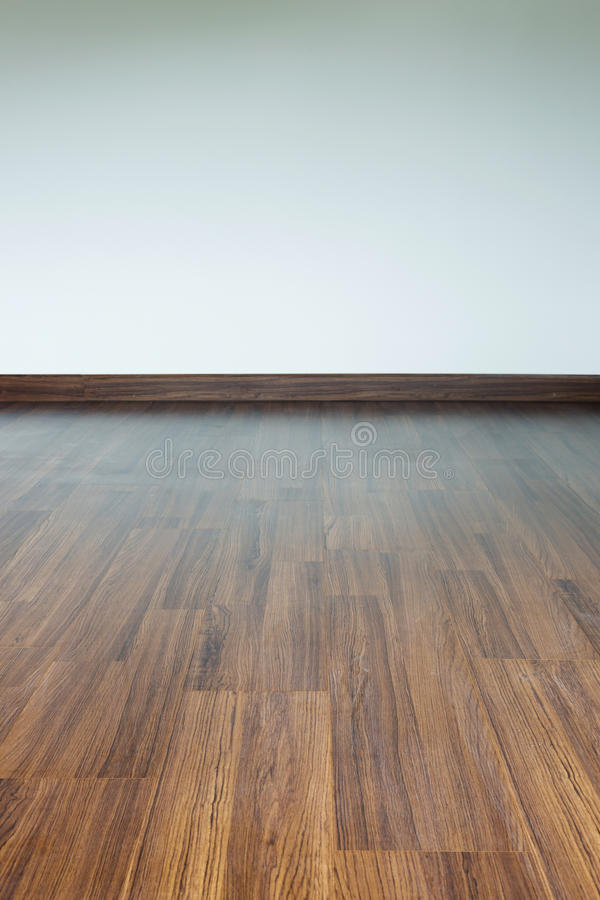 Empty room interior, brown wood laminate floor. And white mortar wall background stock images