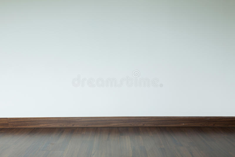 Empty room interior, brown wood laminate floor and white mortar. Empty room interior, white mortar wall background and wood laminate floor in residential house royalty free stock images