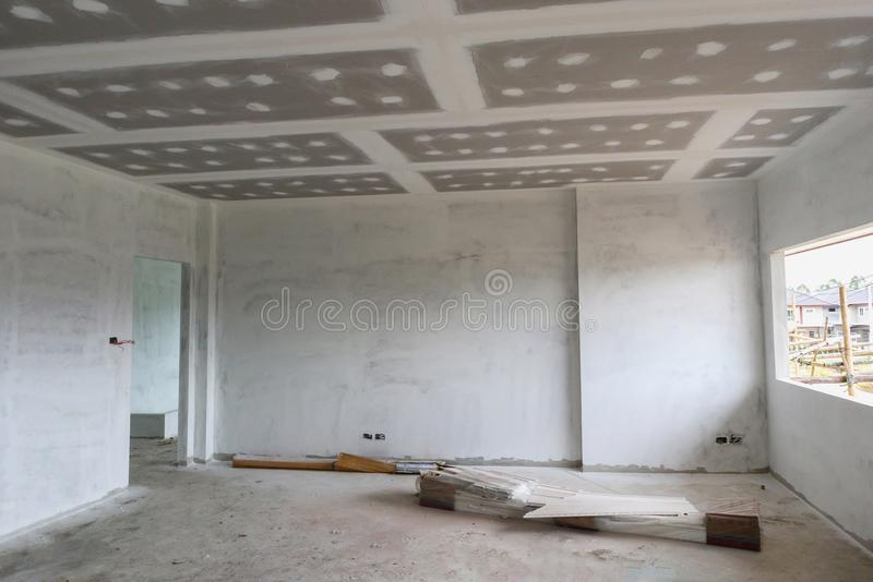 Empty room interior with gypsum board ceiling at construction si royalty free stock images