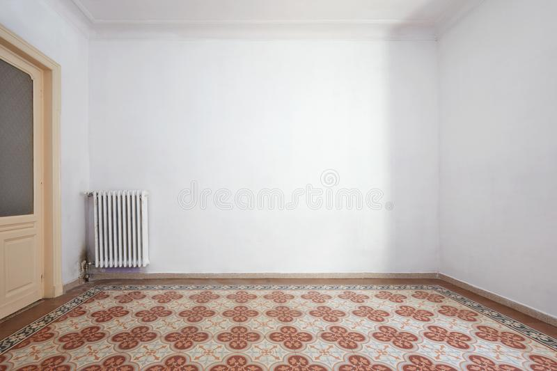 Empty room interior with liberty tiled floor with geometric decoration stock photo