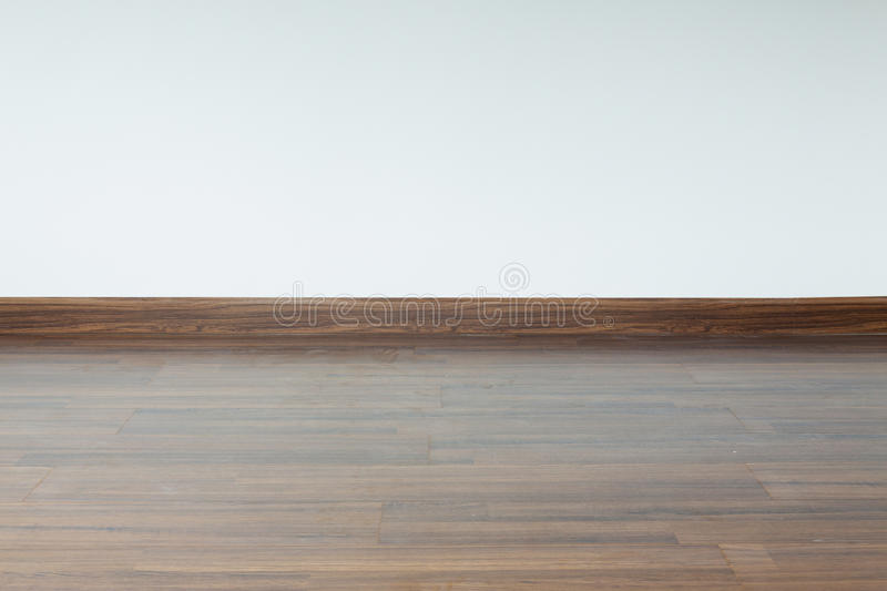 Empty room interior, white mortar wall background. And wood laminate floor in residential house royalty free stock photos