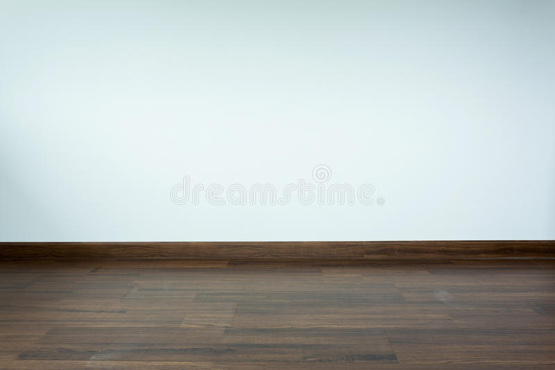 Empty room interior, white mortar wall background. And wood laminate floor in residential house stock images