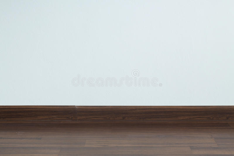 Empty room interior, white mortar wall background and wood. Laminate floor in residential house royalty free stock image