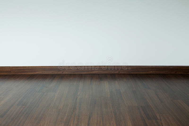 Empty room interior, white mortar wall background. And wood laminate floor in residential house royalty free stock image