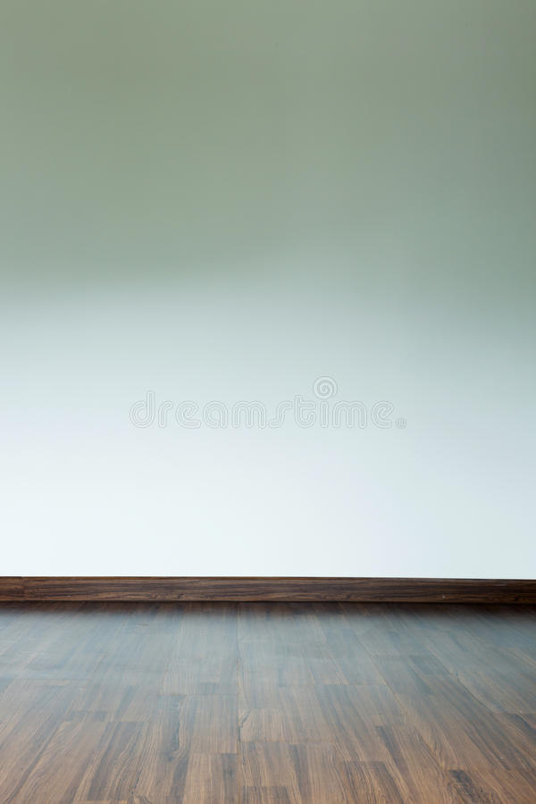 Empty room interior, white mortar wall background. And wood laminate floor in residential house royalty free stock photo