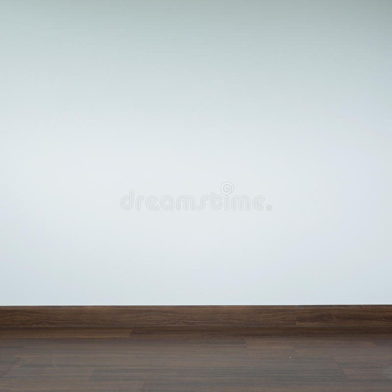 Empty room interior, white mortar wall background. And wood laminate floor in residential house royalty free stock images