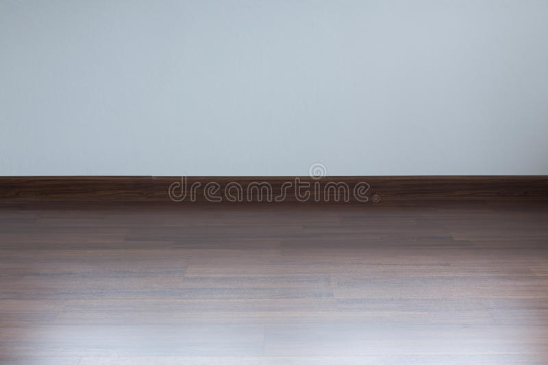 Empty room interior, white tile floor and white mortar wall. Empty room interior, white mortar wall background and wood laminate floor in residential house royalty free stock photos