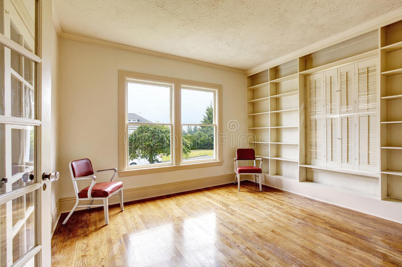 Empty room interior in white tones with wooden shelves royalty free stock photos