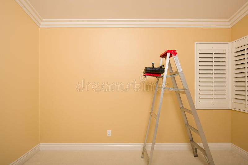 Empty Room with Ladder, Paint Tray and Rollers royalty free stock image