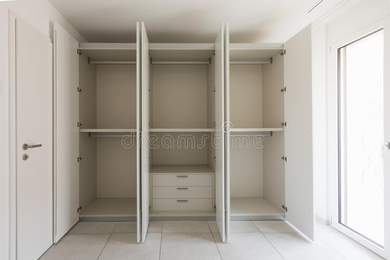 Empty room with large wardrobe stock images