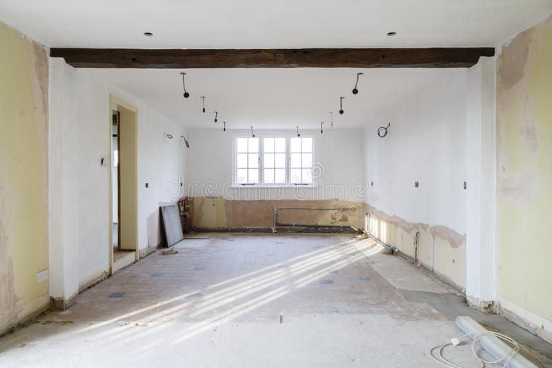 Kitchen ripout before remodeling. Empty room in an old house undergoing refurbishment, remodeling and redecoration, in preparation for a kitchen refit royalty free stock image