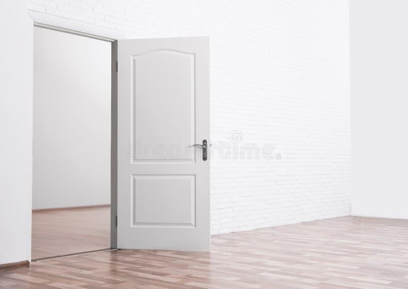 Empty room with open door royalty free stock image