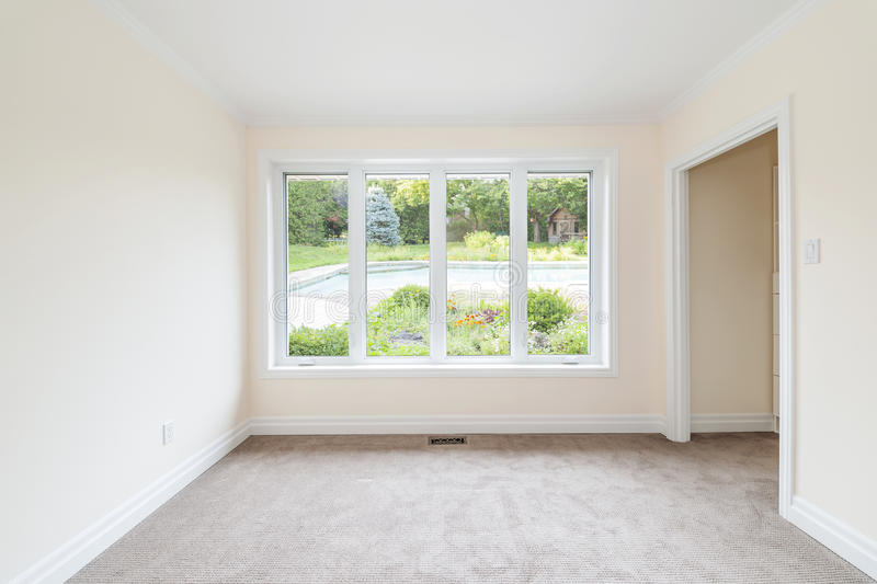 Empty room overlooking backyard stock photography