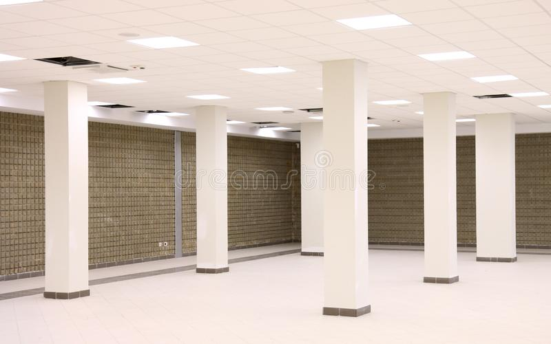 Empty room with reinforced concrete pillars. Empty room under construction with reinforced concrete pillars to support overlying structure stock photography