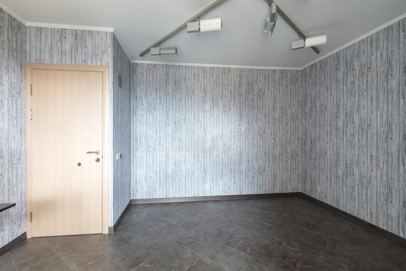 Empty room renovation. Empty room after repair light clean interior with wallpaper stock photos