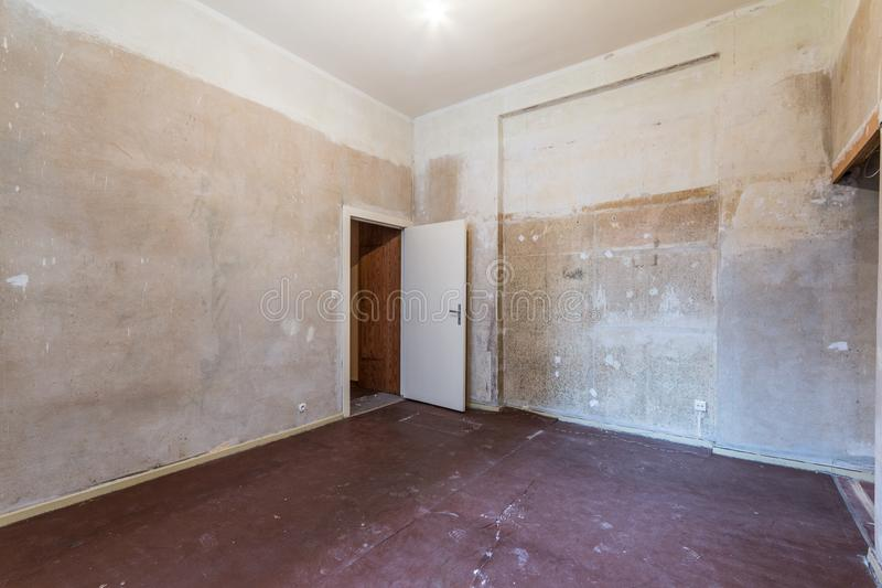 Empty room before renovation - renovating apartment -. Real estate interior before restoration royalty free stock photo