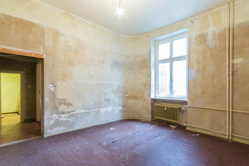 Empty room before renovation - renovating apartment -. Real estate interior before restoration stock photography