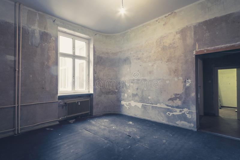 Empty room before renovation - renovating apartment -. Real estate interior before restoration royalty free stock image