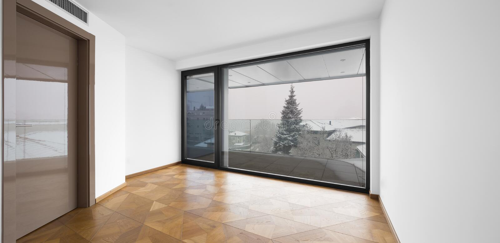 Empty room. It`s snowing outside. royalty free stock image